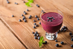 Glass of fresh blueberry smoothie Stock Images