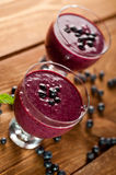 Glass of fresh blueberry smoothie Royalty Free Stock Photos