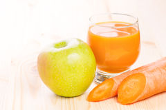 Glass of fresh carrot and apple juice Stock Photography