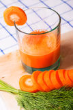 Glass of fresh carrot juice, dill sprigs, sliced carrots Royalty Free Stock Images
