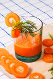 Glass of fresh carrot juice, dill sprigs, sliced carrots Stock Photography