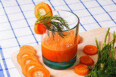 Glass of fresh carrot juice, dill sprigs, sliced carrots Royalty Free Stock Image