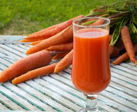 A glass of fresh carrot juice Stock Photo