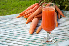 A glass of fresh carrot juice Royalty Free Stock Image