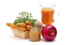 Glass of fresh carrots juice with apple and honey Stock Image