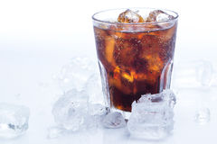 Glass of fresh coke over the white background Stock Photos