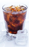 Glass of fresh coke over the white background. Glass of fresh coke with ice Royalty Free Stock Photography