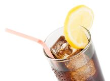 Glass of fresh coke with straw with lemon slice on top, summer time Royalty Free Stock Image