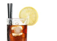 Glass of fresh coke with straw with lemon slice on top, summer time Stock Image