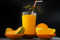 Glass with fresh cold pressed melon-orange juice and fresh fruit Royalty Free Stock Image