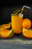 Glass with fresh cold pressed melon-orange juice and fresh fruit Stock Photo