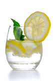 Glass of fresh cool tonic. With lime fruits isolated on white background Royalty Free Stock Photos