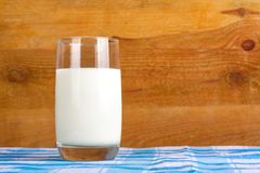 Glass of fresh cow's milk on  tablecloth Royalty Free Stock Photography