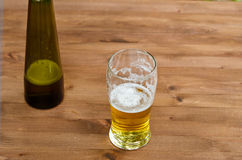 Glass of fresh draft lager beer. On table in pub Stock Image