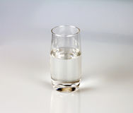 Glass of fresh drink water on grey backgrund. A glass of fresh drink water on grey backgrund royalty free stock photos