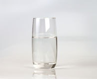 Glass of fresh drink water on grey backgrund Stock Images