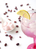 Glass of fresh drinking water with lemon, goji and candy hearts. Stock Photo