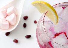 Glass of fresh drinking water with lemon, goji and candy hearts, Stock Image