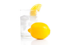 A glass of fresh drinking water and a lime. Glass of fresh drinking water and a lime Royalty Free Stock Photography