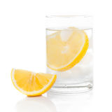 A glass of fresh drinking water and a lime. Glass of fresh drinking water and a lime Stock Photography