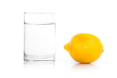 A glass of fresh drinking water and a lime. Fruit isolated Stock Images