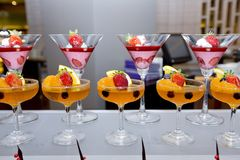 Glass of fresh fruit jelly of buffet.Finger food. Stock Photos