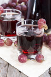 Glass with fresh Grape Juice Stock Images