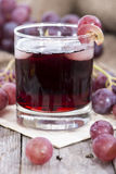 Glass with fresh Grape Juice Royalty Free Stock Image