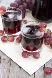Glass with fresh Grape Juice Royalty Free Stock Photos