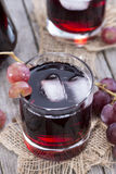Glass with fresh Grape Juice Stock Photos