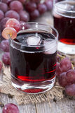 Glass with fresh Grape Juice Royalty Free Stock Images