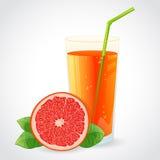 A glass of grapefruit juice and half grapefruit wi Stock Photography