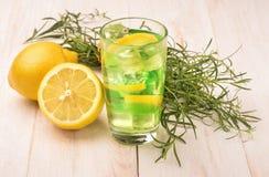Glass of fresh homemade lemonade with tarragon and lemon Stock Photo