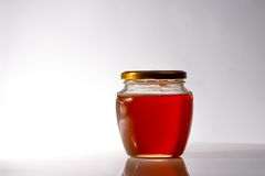 Glass of fresh honey Stock Photos