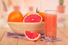 Glass of fresh juice and bowl Stock Photos