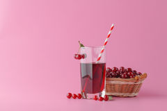 Glass of fresh juice with cherries on bright background Stock Image