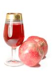 Glass of fresh juice and two pomegranates Royalty Free Stock Photography