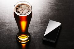 Lager beer on table. Glass of fresh lager beer on black table Stock Photos