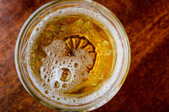 Glass of fresh lager beer. On dark wooden table Stock Photo