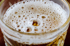 Glass of fresh lager beer. On dark wooden table Royalty Free Stock Images