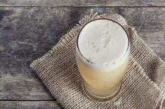 Glass of fresh lager beer. On wooden table Royalty Free Stock Images