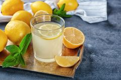 Glass of fresh lemon juice stock image