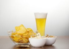 Glass of fresh light beer and snack Royalty Free Stock Photo