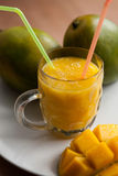 The glass of fresh mango smoothie Stock Image