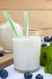 Glass of fresh milk with drinking straw Royalty Free Stock Images