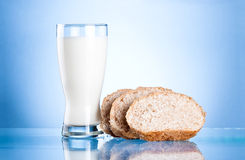 Glass of fresh milk and Three Bread Slices Royalty Free Stock Photos