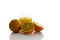 Glass with fresh orange juice Stock Photos