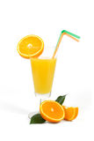 Glass of fresh orange juice with green and orange tubule isolated on white Royalty Free Stock Photos