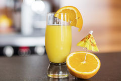 Glass of fresh orange juice on a kitchen countertop Stock Photography