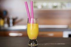 Glass of fresh orange juice on a kitchen countertop Stock Photo